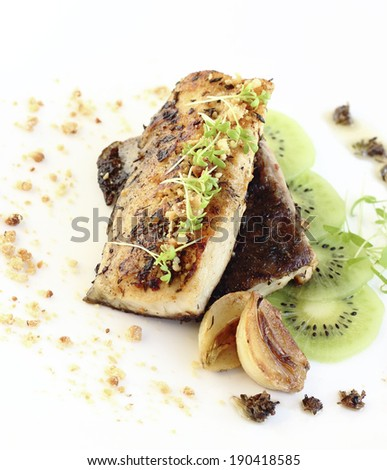close up fried fish fillet served with kiwi - stock photo