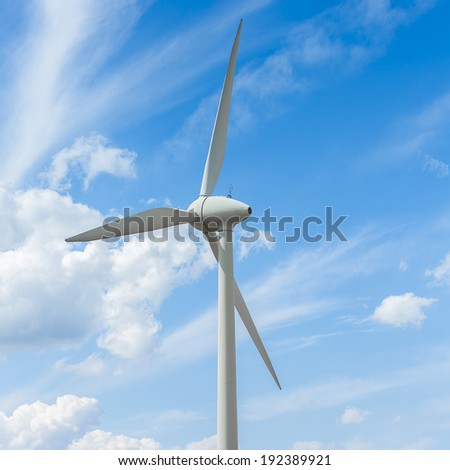 Close-up from a Wind turbine on cloudy blue sky Alternative Energy power