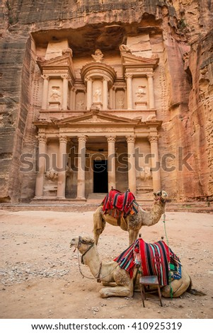 Close-up front view of the famous Al-Khazneh (aka Treasury) with camels resting next to it in the ancient city of Petra (Jordan) - stock photo