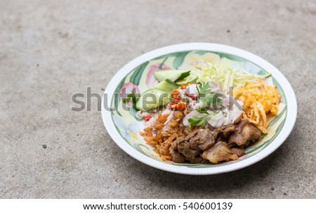 close up fry rice kapi menu with vegetable on cement show concept street food of thailand