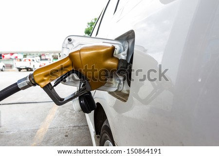 Close-up fuel nozzle.  Fill up fuel at gas station - stock photo