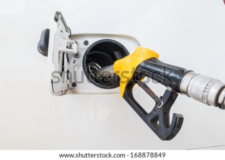 Close-up fuel nozzle. Fill up fuel at gas station. - stock photo
