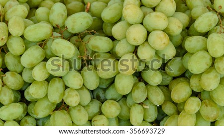 Close-up full frame view of fresh green grapes for sale at a local fruits market in Singapore. Natural food background. Panoramic style - stock photo