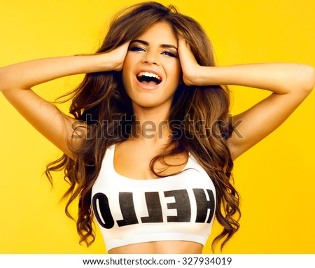Close up funny portrait of sexy young pretty girl listening music on big earphones, wearing cute sunglasses.funny cute smiling woman. Beautiful laughing girl.White background, not isolated,hipsters - stock photo