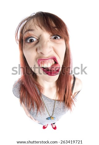 Close up Funny Young Woman with Tongue Out, Zooming her Face While Looking at the Camera, Isolated on White Background. - stock photo