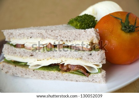 close up gaba bread with bacon and chicken sandwich