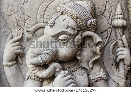 Close up ganesh hindu god face, Ganesha made from stucco work.  - stock photo