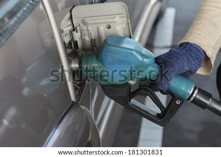 close up gas pump for refueling car on gas station