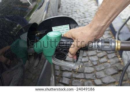 close up gas pump for refueling car on gas station - stock photo
