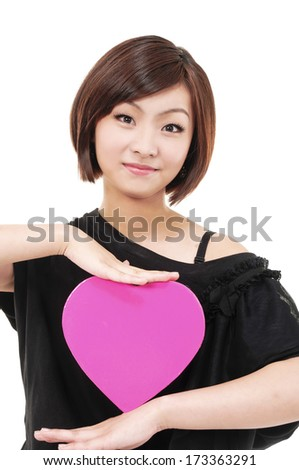 Close up Girl with big heart red gift box - stock photo