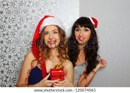 Close-up girlfriends hold gifts at christmas party