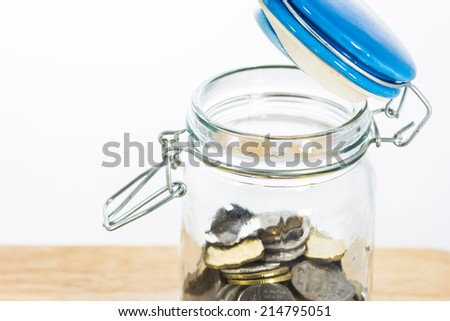 close up glass jars ,coin - stock photo