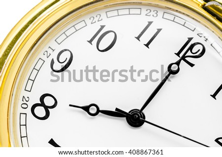 Close up gold clock face on white background. - stock photo