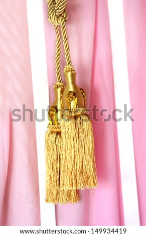 Close up gold color elegance curtain tassel in luxury house  - stock photo