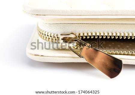 Close up gold zip wallet - stock photo