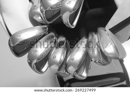 close up golf clubs in bag - stock photo