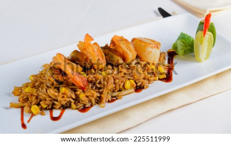 Close up Gourmet Lemony Risotto Recipe on White Rectangular Plate, Emphasizing Tasty Prawns on Top. - stock photo
