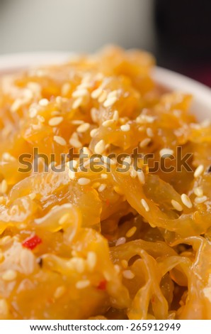 close up gourmet tossed jellyfish salad in white bowl , Chinese cuisine - stock photo