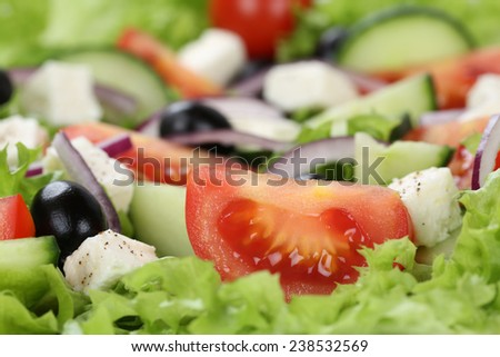 Close up Greek salad with tomatoes, Feta cheese, onions and olives - stock photo