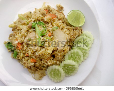 Close up green curry fried rice on dish, Delicious fried rice with chicken green curry, Thai Food - stock photo