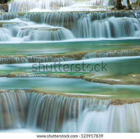 Close up green forest waterfall Huay Mae Kamin National Park Kanjanaburi Thailand - stock photo