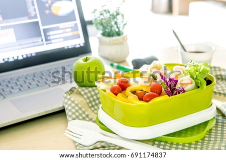 close green lunch box on work stock photo royalty free 691174837
