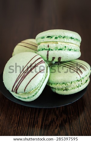 close-up green pistachio flavoured french macaroons - stock photo