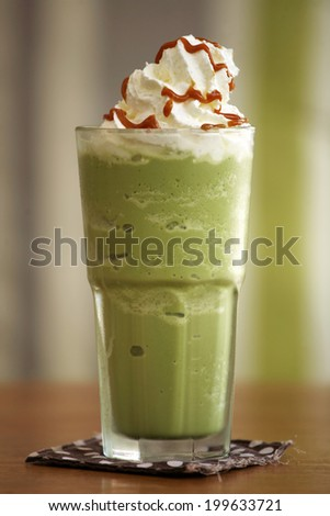 close up green tea and cream in coffee shop - stock photo