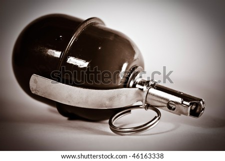 close-up grenade on the white background - stock photo