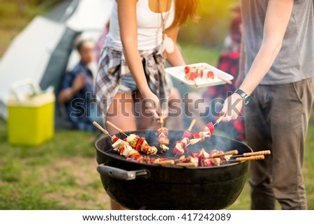 Close up grill with colorful barbecue on grill in campground - stock photo
