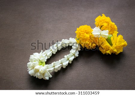 close up group of Jasmine and Yellow Marigold Garland flower for Pay homage to the Buddha - stock photo