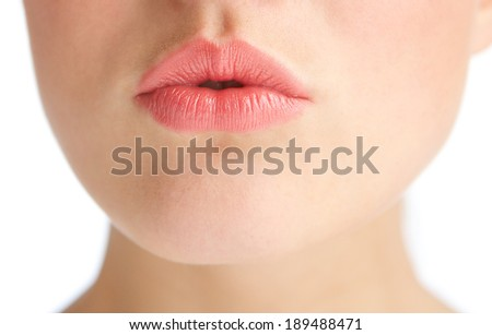 Close up half face portrait of a beautiful young woman with kissing lips - stock photo