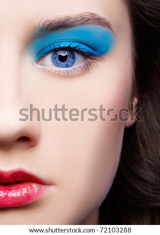 close-up half face portrait of beautiful girl's make-up - stock photo