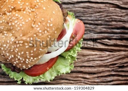 Close-up hamburger on the wood - stock photo
