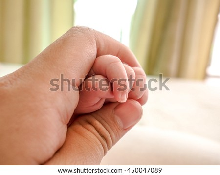 close-up hand baby in the hand of mother. happy family