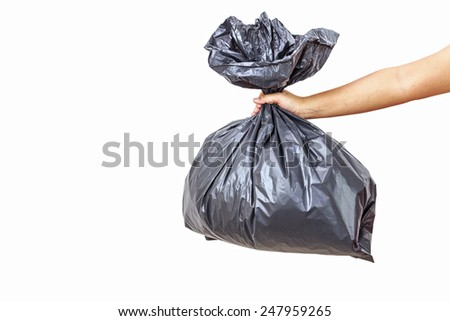 Close up Hand holding a garbage bag on white background - stock photo