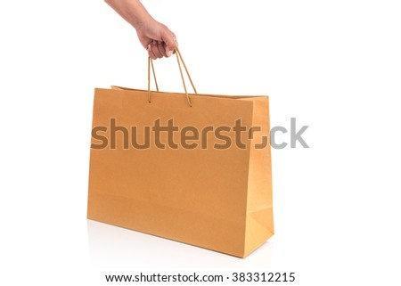 Close up hand holding brown paper bag isolated on white background - stock photo