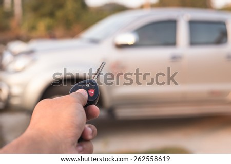Close up Hand holding car key - stock photo