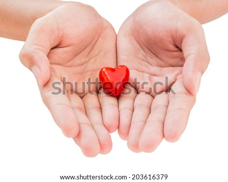 Close up hand holding small piece of red heart isolated on white background,blood donation concept