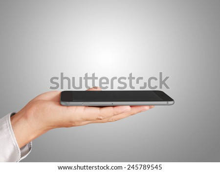 Close up hand holding smart phone  - stock photo