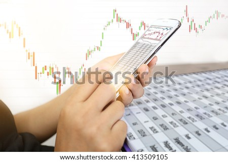 Close up hand of business girl check stock trench by smart phone with stock graphic chart - stock photo