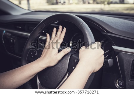 Close up hand of driver on steering