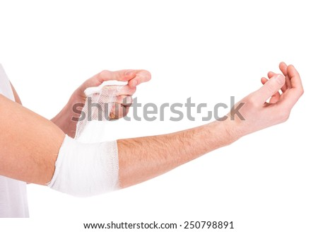 Close-up hand of man, injured painful elbow with white bandage. - stock photo