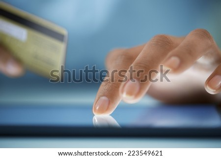 Close-up hand Woman shopping online with digital tablet - stock photo