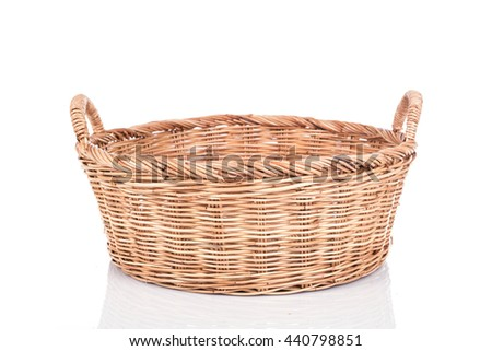 Close up handmade rattan basket isolated on white background - stock photo