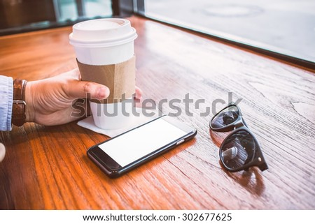 close up hands multitasking man using cellphone connecting wifi - stock photo