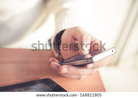 close up hands multitasking man using tablet, laptop and cellphone connecting wifi