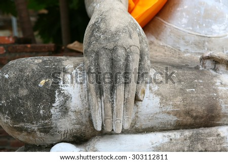Close up hands of buddha statue - stock photo