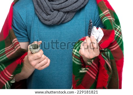 Close-up hands of man is holding a money and pills. - stock photo