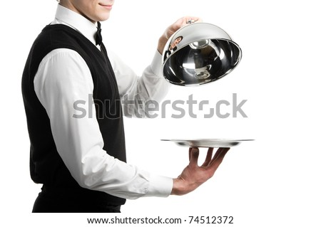Close up hands of waiter with metal cloche lid cover - stock photo